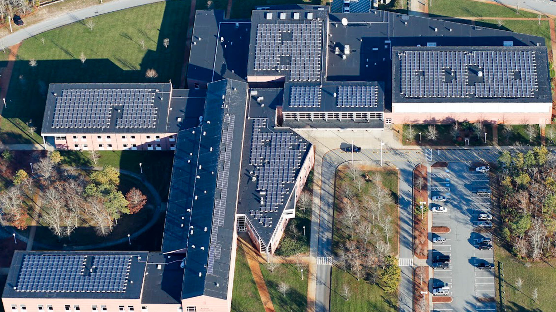aerial view of solar panels on build tops