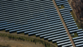 aerial shot of dozens of solar panels in a field